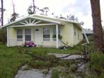 A fallen rain gutter is the only sign of hurricane damage for this home.