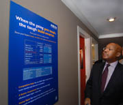 U.S. Department of Housing and Urban Development Secretary Alphonso Jackson reviews PATH information about the NextGen