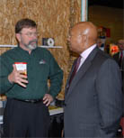 U.S. Department of Housing and Urban Development Secretary Alphonso Jackson visits with a representative from the Structural Insulated Panel Association at the International Builders' Show.