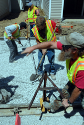 Workers install pervious pavement at Liberty Village in Lincoln, Nebraska.